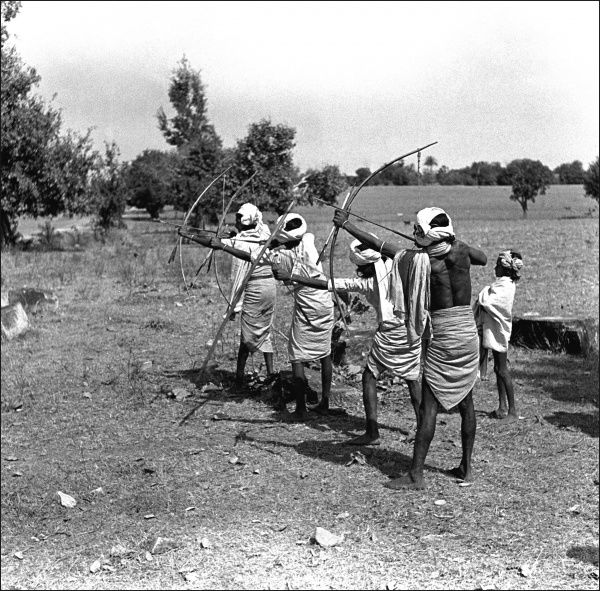 Men from the Madhya Pradesh Province, India practise their archery. Photograph by Ralph Ponsonby Watts