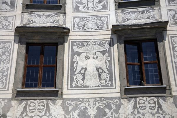 Architectural detail of an angel fresco and windows on the Palazzo della Carovana in Pisa, Italy
