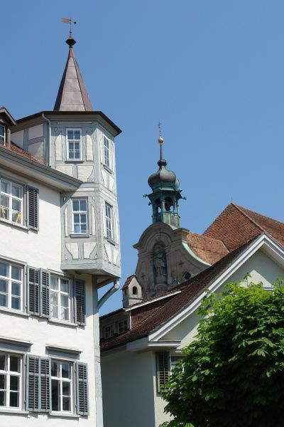 Architectural details in the old part of St Gallen, Switzerland, including a turret room that juts out from the corner of a building