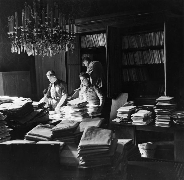 Gendarme officers in the archive service of the Paris Peace Conference which followed the end of the First World War. It was their job to classify three tons of documents. Date: circa 1919