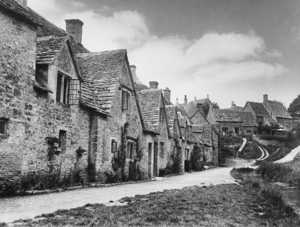These cottages on Arlington Row, Bibury, Gloucestershire, England, are fine examples of Cotswold architecture and were originally a wool store dating back to the 14th century