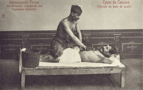 Armenian Bathhouse - Sulphur Baths. The attendant is wearing a camel hair mitten, which is using to rub the bather all over which cleanses and exfoliates! Date: circa 1910s