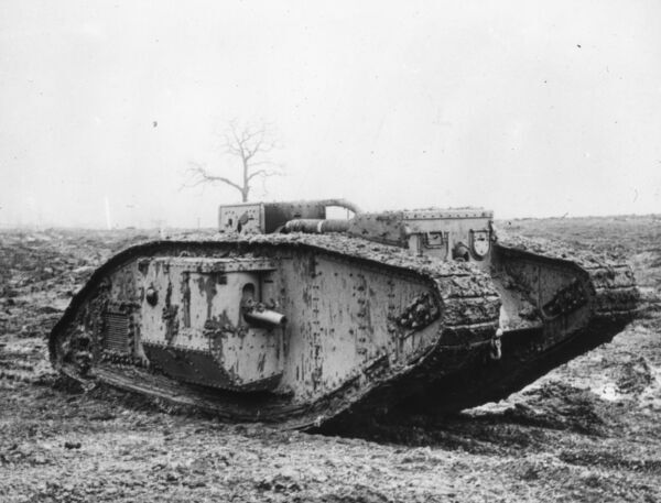 View of an armoured tank sitting on a battlefield during the First World War