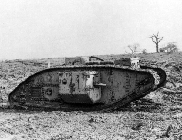 An armoured tank on a battlefield on the Western Front during the First World War. Date: circa 1916-1918