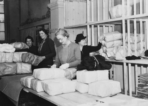 Women working in the Army Comforts Depot where gifts are packed and despatched to British troops during World War II