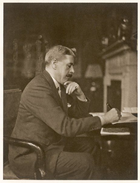 ENOCH ARNOLD BENNETT English novelist, dramatist and critic writing at his desk