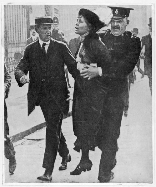 Mrs Pankhurst is lifted off the ground when arrested outside Buckingham Palace