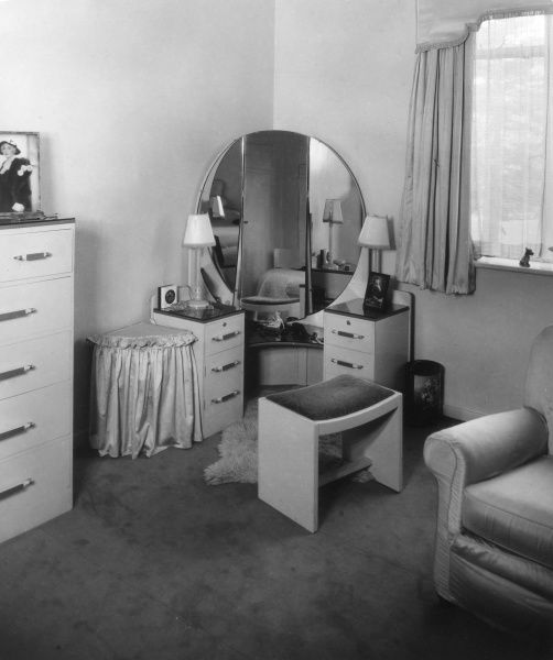 A 'modern' Art Deco style dressing table and 'tall boy' chest of drawers. Date: 1930s