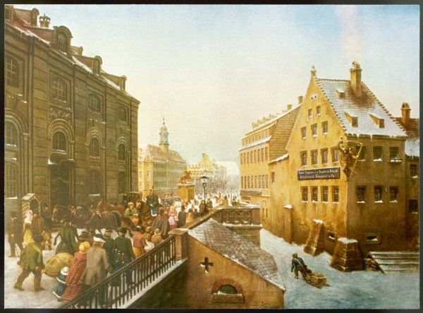 Jovial winter scene on the August-Bridge in Dresden showing crowds enjoying the snow and winter sunshine