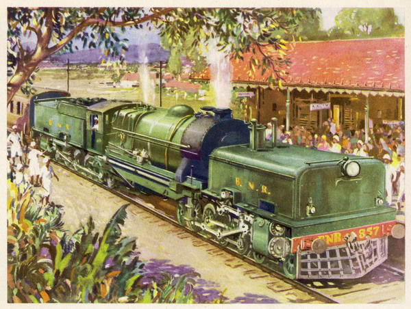 The glory of steam ! A magnificent Beyer-Garratt articulated locomotive of the Bengal Nagpur Railway draws into a station crowded with travellers