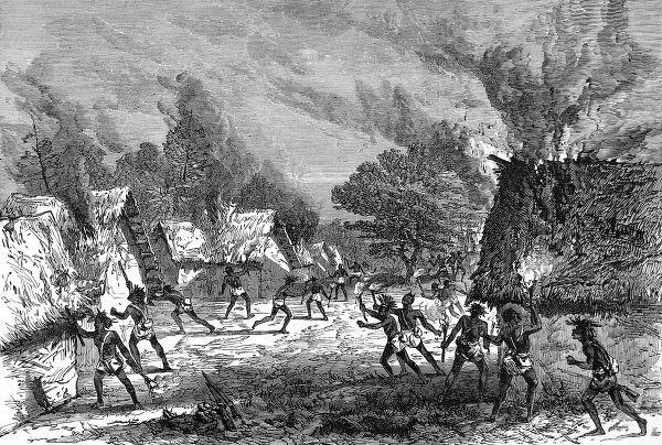 Lord Gifford's scouts setting fire to a village and destroying houses during their advance on the Ashanti. The second Ashanti War fought between,1873-74, was between King Kofi Karikari, ruler of the Ashanti (or Asantehene), and the British