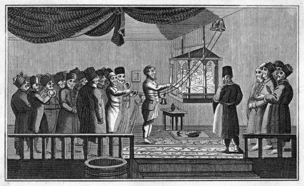 Tartar merchants of Astrakhan (Russia) at prayer before a kind of suspended altar containing figures, contrary to Islamic teachings