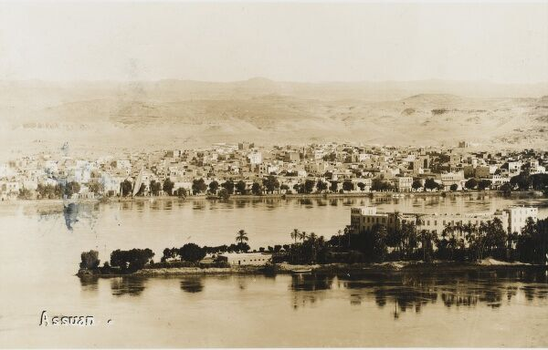 A panoramic view of Aswan, Egypt. The city stands on the east bank of the Nile at the first cataract and is a busy market and tourist center. Its ancient name, Swenet, translates as 'trade'. It contains the island of Elephantine