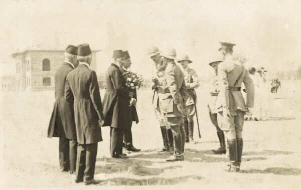 Kemal Pasa (Ataturk) and General Harrington (commanding the British troops) - 'compromising on neutral ground' in 1923. A very interesting photograph as it shows a Turkish delegation approaching an official meeting with a gift of flowers