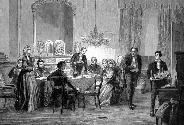 A Victorian family around a dining table during the distribution of envelopes of money, or 'Christmas boxes' to servants