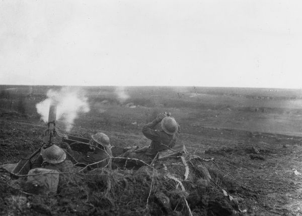 Australian gunners of No. 4 Section, 22nd Machine Gun Company, in action against a German aeroplane in the Noreuil Valley, near Bullecourt (2nd Battle of the Scarpe) during the Battle of Arras, northern France, First World War. Date: 23 April 1917