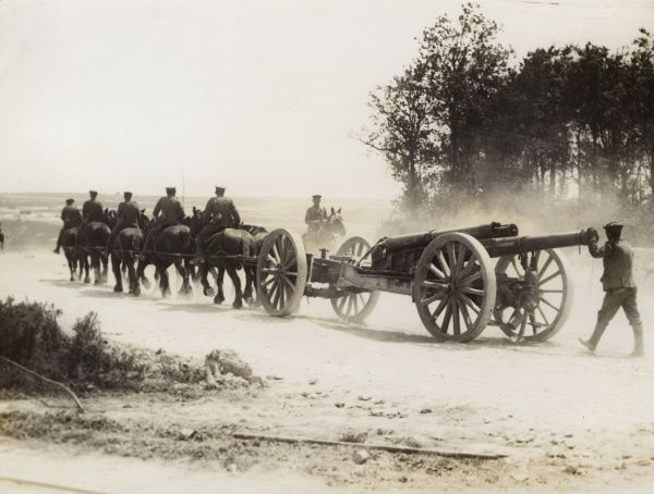 Australian gunners and horses transporting a heavy gun on the Western Front during the First World War. Date: 1914-1918