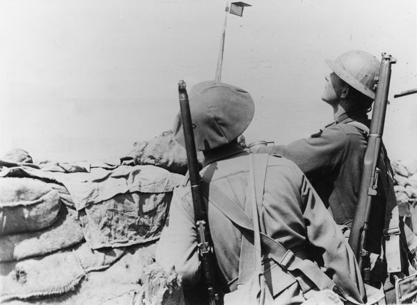 Australian soldiers in a front line trench at Croix du Bac, near Armentieres, northern France, during the First World War. They are using a mirror periscope. Date: 18 May 1916