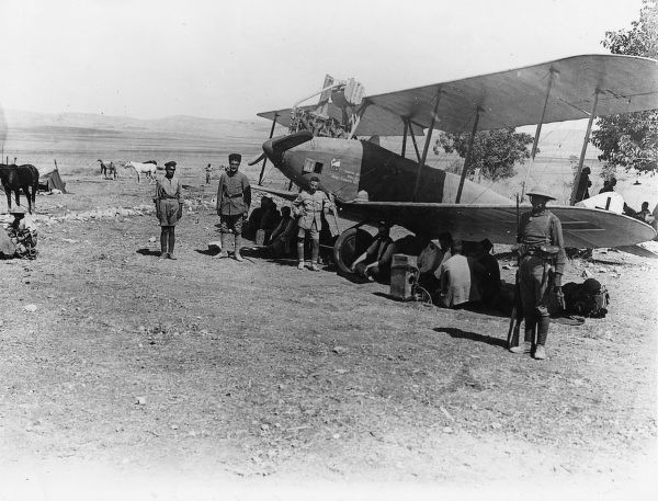 Men of the 3rd Australian Light Horse Brigade guarding a captured enemy plane at Janin airfield, Palestine, during the First World War. Date: 1914-1918