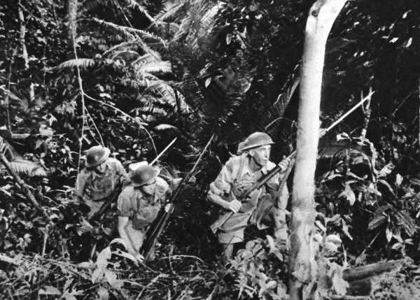 Australian troops train in the thick jungle of Malaya, in anticipation of the Japanese invasion, which came in December 1941. Date: 1941