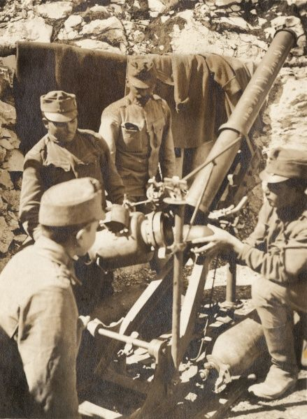 Austro-Hungarian gunners loading a 12cm trench mortar during the First World War. Date: 1914-1918