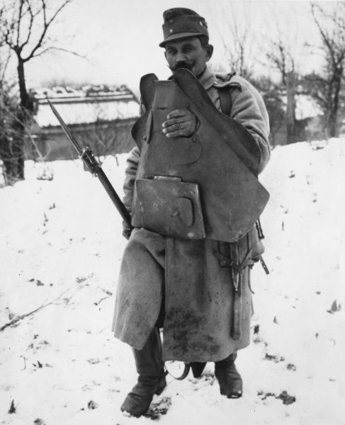 An Austro-Hungarian soldier holding a defence shield in front of him in Galicia, on the Eastern Front, during the First World War. Date: 1914-1918