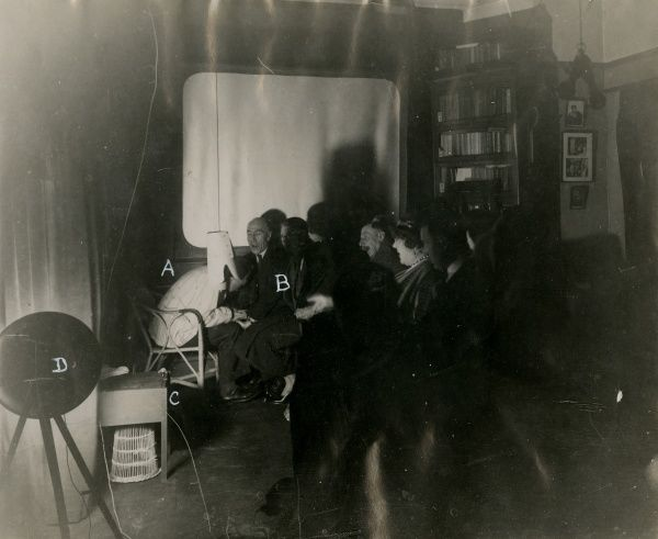 Automatic photograph of sitters and Rudi Schneider at a sance at the National Laboratory of Psychical Research during which a rising handkerchief was photographed, 3 March 1932