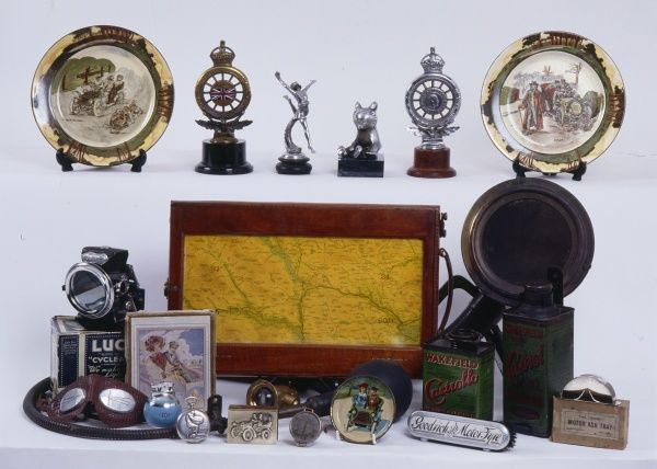 A splendid collection of Automobilia Ephemera, including goggles, a 'rigid ash tray', a map and a long curved car horn!