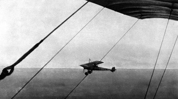 A French 'parasol' monoplane flying at nearly 10,000 feet, photographed by another French machine. The photograph was taken during an engagement with German aircraft near Nancy