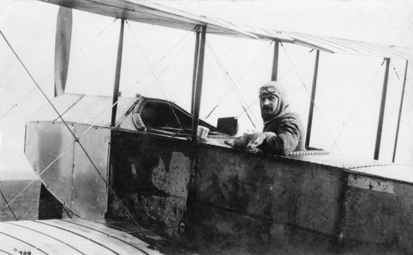 An Avro (A V Roe) biplane with pilot sitting in the cockpit during the First World War. Date: 1914-1918