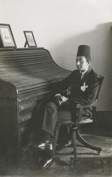 Egypt man - Awad Kamel Fahmy, sitting in his revolving chair in front of a rather impressive roll-top desk