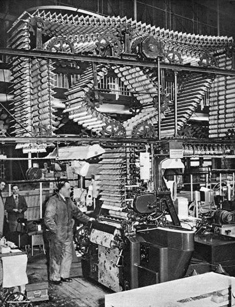 A large Axminster carpet loom on display and in action in the Power and Production Pavilion, Festival of Britain, South Bank, London. Date: May 1951