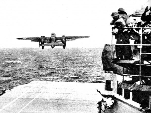 Photograph showing an American B-25 Mitchell medium bomber taking off from the aircraft carrier 'Hornet' on 18th April 1942