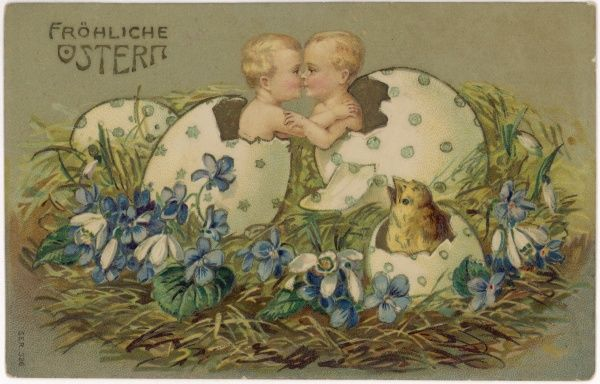 Two babies and a chick hatching out of large decorated Easter eggs -- the babies kiss !