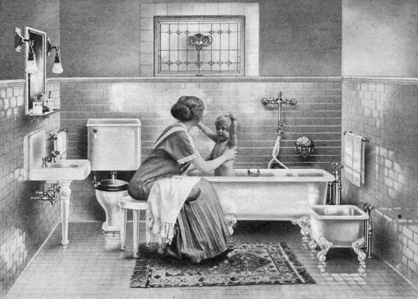 Mother and baby in a modern bathroom