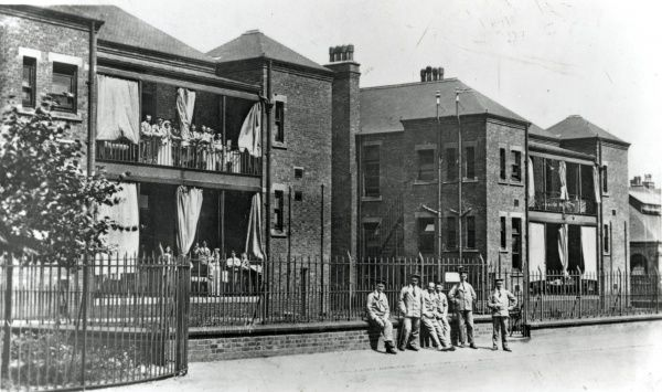 Soldiers and nurses pose in front of the Bagthorpe Military Hospital - the First World War guise of Nottingham's workhouse infirmary, now part of the City Hospital