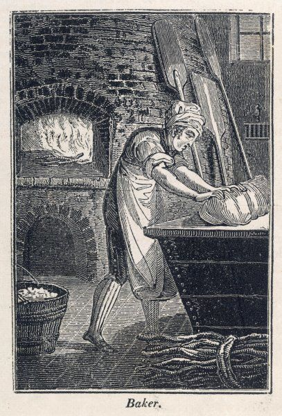 A baker kneading dough. He wears an apron and there is a bundle of sticks of firewood (for the kiln) beside him