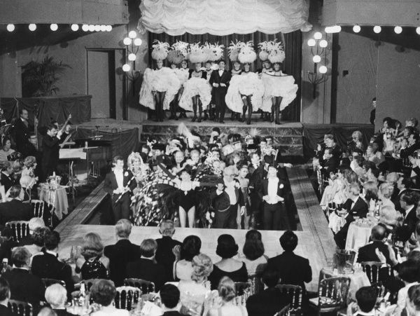 A glitzy show at the Bal Tabarin nightclub (location unknown) is appreciated by the smartly-dressed audience Date: 1960s