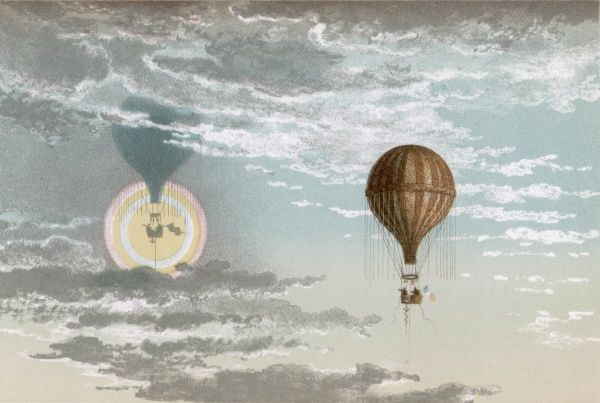 A hot air balloon with mirage and reflection