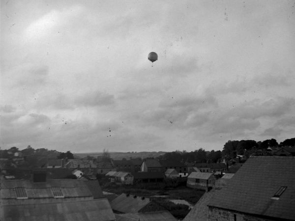A hot air balloon high up over the Prendergast area of Haverfordwest, Pembrokeshire, Dyfed, South Wales, as seen from the quay