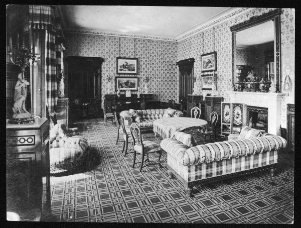 The Drawing Room at Balmoral. With tartan covered furniture and a checked carpet