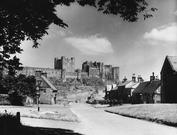 Bamburgh Castle, perched on a basalt outcrop on the edge of the North Sea at Bamburgh, Northumberland, it played a great part in the Border Wars (with Scotland)