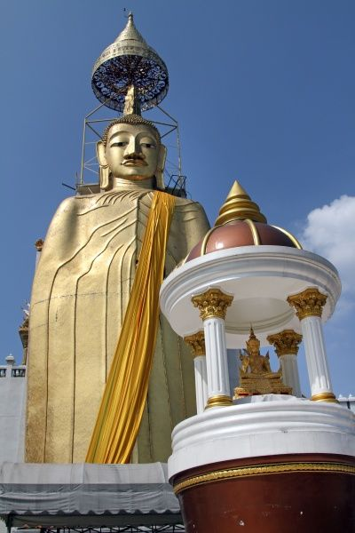 Golden buddha statue at Wat Intharawihan, the tallest standing buddha temple in Bangkok, Thailand