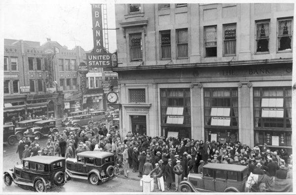 Following the Wall Street crash of 1929, the Brooklyn branch of the Bank of the United States closes its doors. A crowd of people have gathered outside, no doubt wanting their money back