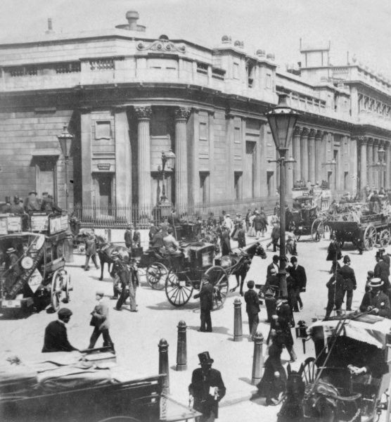 Street scene outside the Bank of England in Threadneedle Street, City of London, on a busy day