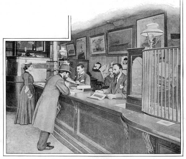 A gentleman being served at the counter of a high street bank in Osborn Street, Whitechapel, London