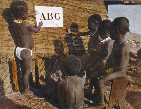 Young African children learn the alphabet at a Baptist Missin, Africa