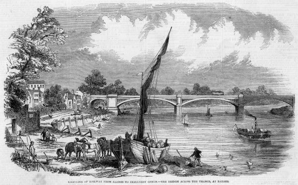 The railway bridge at Barnes, carrying the loopline across the Thames to Smallbery : the sailing boat in the foreground is evidently used to carry cargo by water