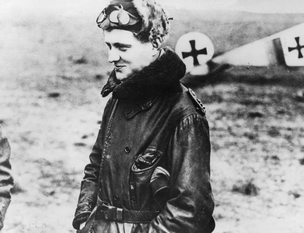 Baron Manfred Albrecht Freiherr von Richthofen (1892-1918), also known as the Red Baron, legendary German fighter pilot during the First World War. Seen here just after landing from a combat flight in an early Fokker plane (possibly a Dr.I)