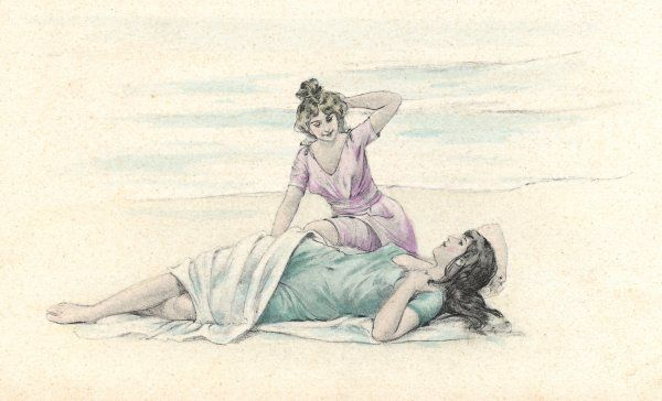 Two bathing beauties, one in pink, one in blue, relaxing on the beach
